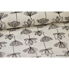Tissu Viscose fluide imprimé fleurs de lotus noir sur blanc .x1m