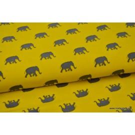 Tissu Viscose fluide imprimé éléphants gris sur moutarde .x1m