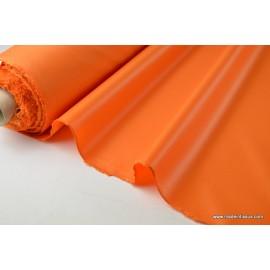 Tissu polyester orange déperlant pour parapluie .