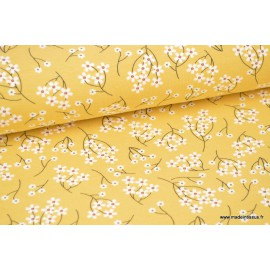 Tissu jersey modal élasthanne moutarde fleur blanche