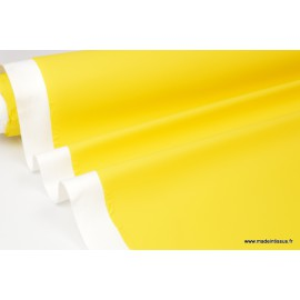 Tissu ciré de pluie jaune uni