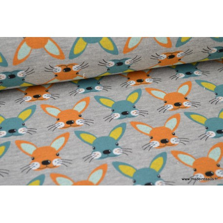 Tissu Jersey envers Minky imprimé lapins turquoise fond écru