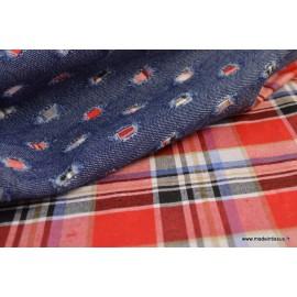 Tissu jean troué contrecollé écossais