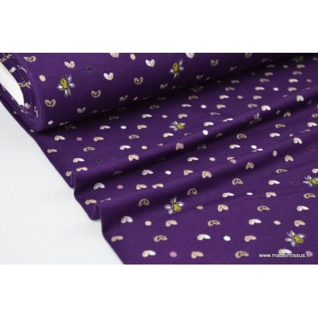 Tissu jersey Viscose imprimé papillons beige sur fond violet
