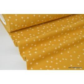 Tissu Flanelle imprimé petites croix fond Moutarde .x1m