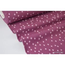 Tissu Flanelle imprimé petites croix fond violet prune