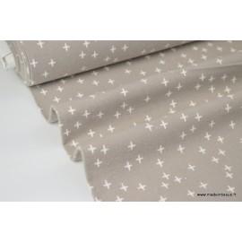 Tissu Flanelle imprimé petites croix fond Gris .x1m