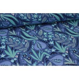 Tissu jersey imprimé feuilles fond bleu
