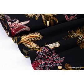 Tissu sergé Viscose fluide imprimé fleurs prune et moutarde fond noir
