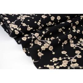 Viscose fluide imprimé fleurs écru sur fond Noir