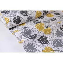 Tissu Double gaze Oeko tex imprimée feuilles moutardes et grises x1m