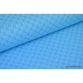 Tissu popeline coton imprimé dessin disc blanc sur turquoise x50cm
