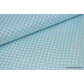 Tissu popeline coton imprimé dessin disc turquoise sur blanc x50cm