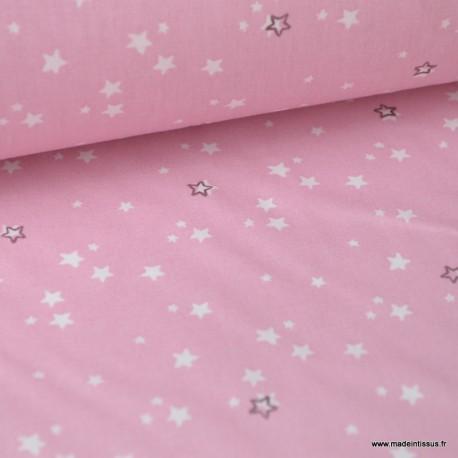 Tissu coton imprimé étoiles blanches fond rose