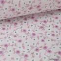 Tissu coton imprimé fleurs roses sur fond rose poudré