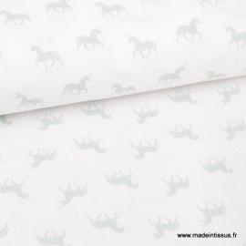 Tissu Tissu Double gaze Oeko tex imprimée licornes Menthe sur fond blanc x1m