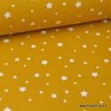 Tissu coton étoiles multiples moutarde