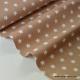 Tissu popeline coton beige étoiles blanches