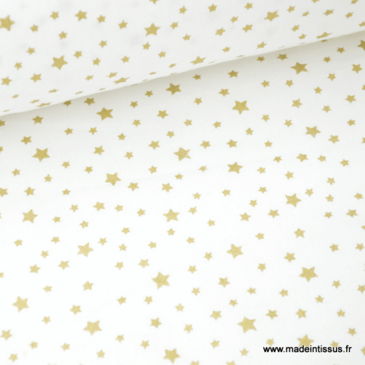 Tissu coton imprimé dessin étoiles vieil or sur fond blanc
