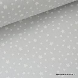 Tissu coton imprimé dessin étoiles blanc sur gris