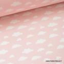 Tissu 100%coton dessin nuages blancs sur fond rose