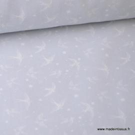 Tissu popeline coton imprimé Hirondelles fond gris