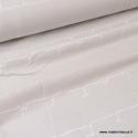 Tissu jersey french terry BIO imprimé écritures blanches et or fond gris