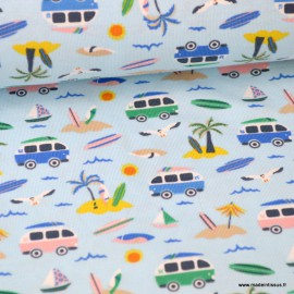Tissu jersey Oeko tex imprimé petits Combis vans et palmiers fond bleu