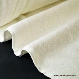 Tissu Eponge coton ecru lisiere cousue fermée .x1m