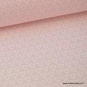 Tissu 100% coton dessin triangles blanc fond rose