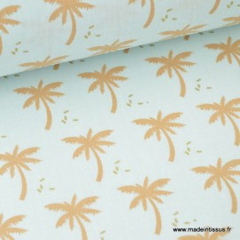 Tissu coton imprimé Palmiers sur fond menthe .x1m