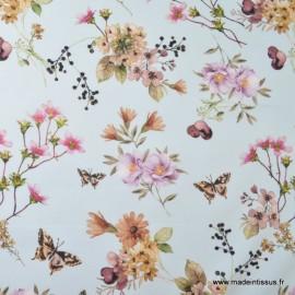 Tissu sergé coton imprimé fleurs et papillons sur fond bleu x50cm