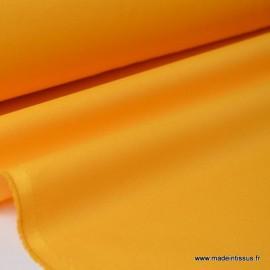 Tissu Gabardine enduite étanche jaune moutarde.