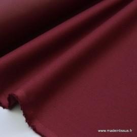 Tissu Gabardine enduite étanche bordeaux.