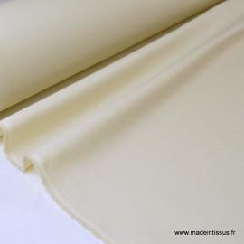 Tissu Gabardine enduite étanche écru.