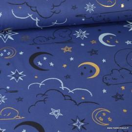 Tissu jersey Oeko tex imprimé Etoiles, lunes et nuages Or et noir fond bleu marine