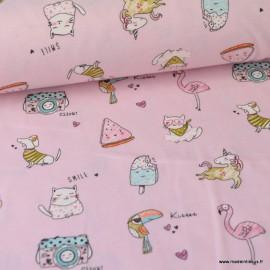 Tissu Jersey imprimé Licornes, flamants, chiens appareils photos, glaces et chats fond Rose