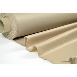 Tissu leger imperméable étanche polyester enduit acrylique beige .