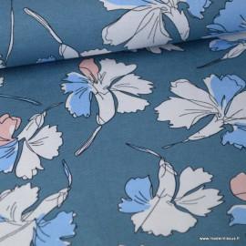 Tissu jersey Viscose imprimé fleurs roses et bleus fond bleu