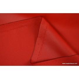 Tissu imperméable étanche polyester enduit acrylique rouge .
