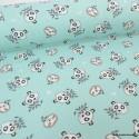 Tissu coton Oeko tex imprimé Têtes de Pandas et de Paresseux fond Jade
