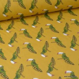 Tissu coton imprimé Perroquets Kaki fond Ocre