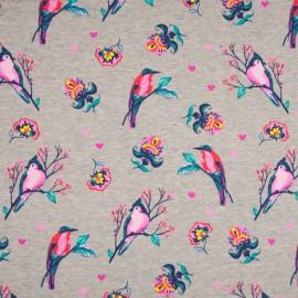 Tissu sweat envers molleton fond gris imprimé oiseaux rose et pétrole