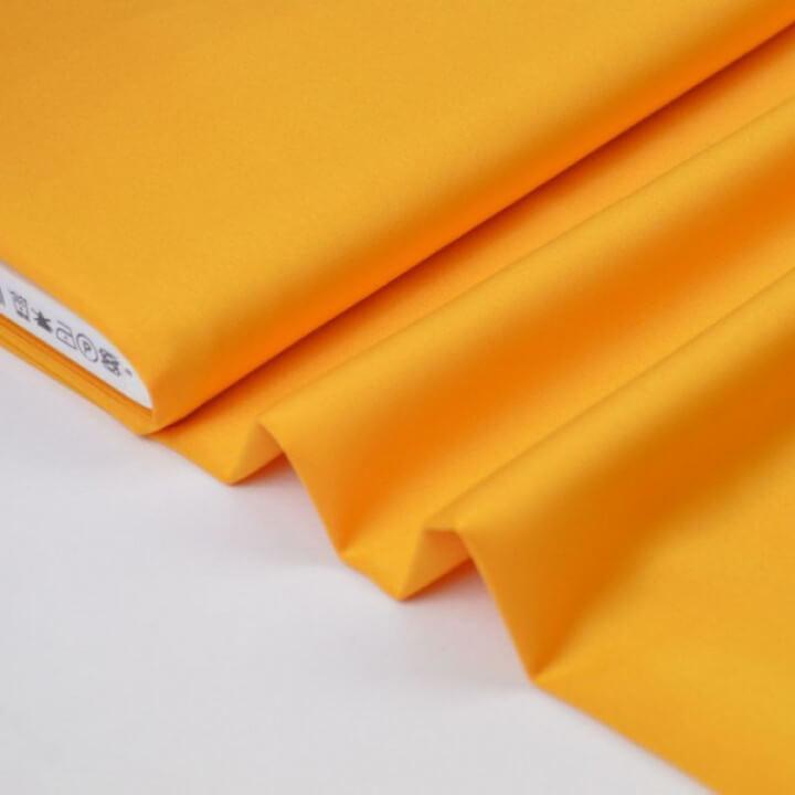Tissu satin microfibre fluide uni moutarde   x50cm
