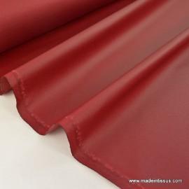 Tissu imperméable étanche polyester enduit acrylique bordeaux  .