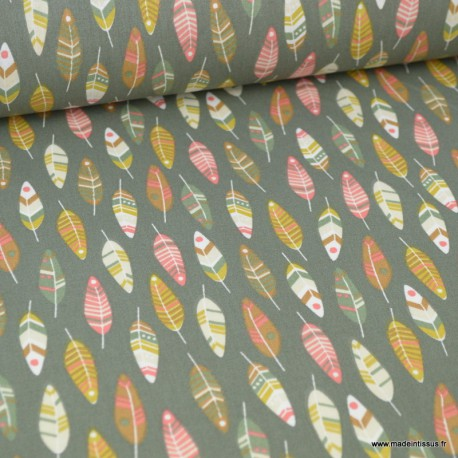 Tissu coton imprimé plumes moutardes et vertes fond Kaki. Oeko tex