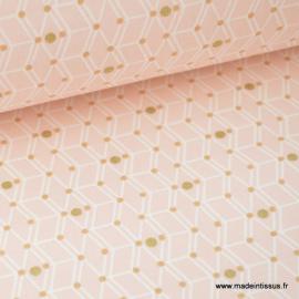 Tissu 100% coton formes géométriques sur fond rose pale .x1m