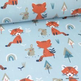 Tissu coton imprimé Renards, lapins et sapins fond bleu Glacier . Oeko tex