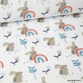 Tissu coton imprimé Lapins et arc en ciel bleu fond blanc. Oeko tex