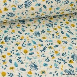 Tissu Sweat imprimé fleurs Bleu pétrole et moutarde fond écru chiné envers Minky .x1m